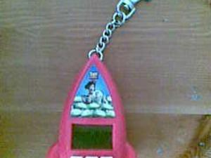 Toy Story key chain game The Claw