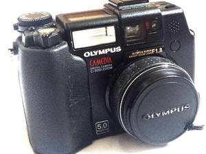 Olympus C-5050 with case, cards, straps, leads, charger + accessories - all in original packing.