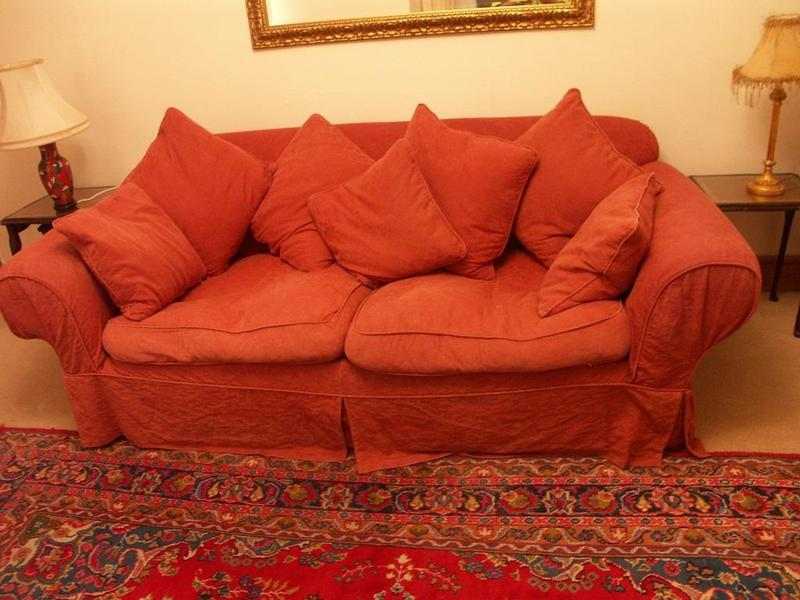 LARGE RED SOFA WITH SCATTER CUSHIONS In Redhill Friday Ad