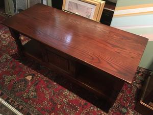 SOLID OAK COFFEE TABLE WITH STORAGE CUPBOARD in Brighton