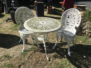 round vintage garden table and two chairs